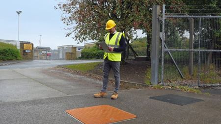Composite manhole covers for remote underground monitoring