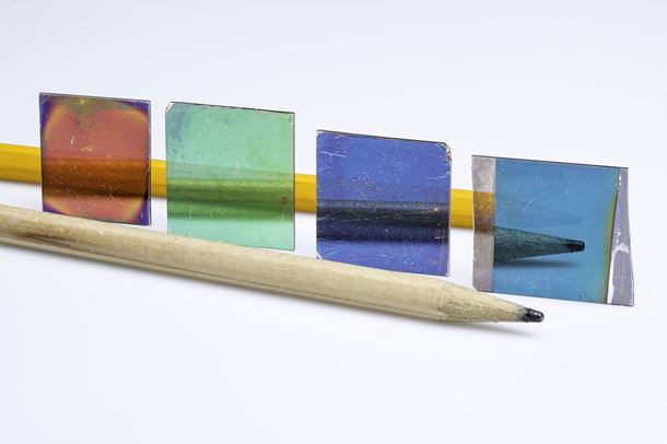 An optical coating that exhibits the same color in reflection (pictured) and transmission.  Photo Credit: Adam Fenster at the University of Rochester