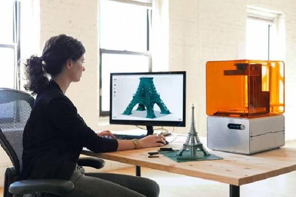 A user works away on Formlabs' Form 1 3-D printer and PreForm software. Courtesy of Formlabs.
