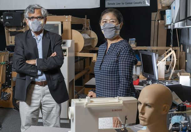 Georgia Tech professor Sundaresan Jayaraman and principal research scientist Sungmee Park wear prototypes of their redesigned face mask (credit: Christopher Moore, Georgia Tech)